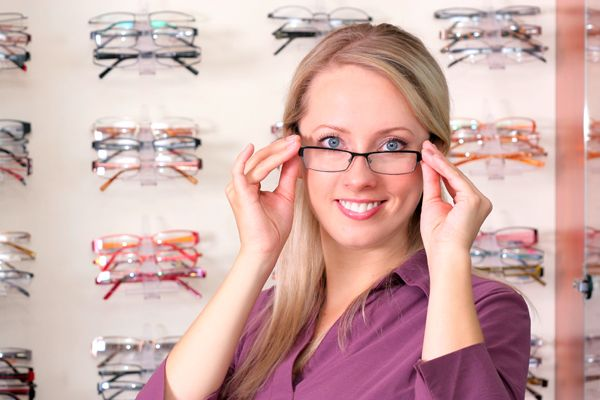 Woman wearing designer glasses